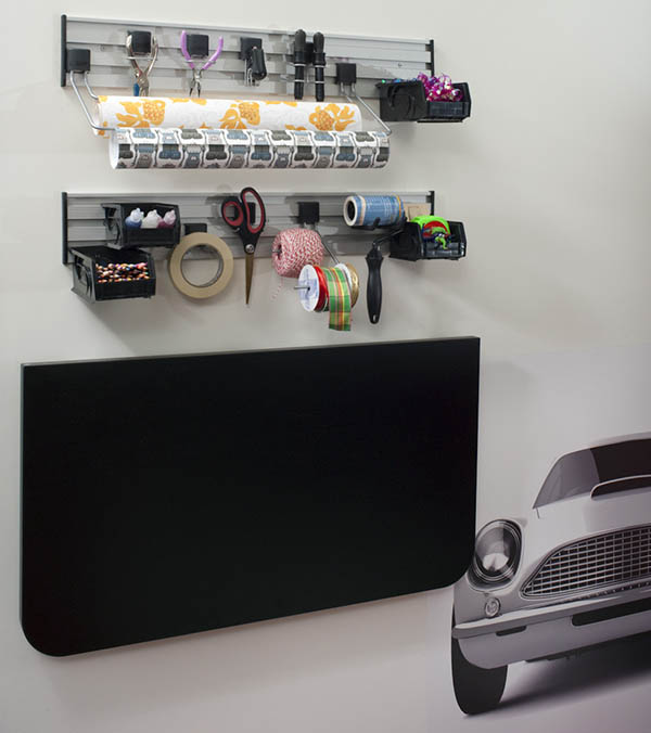 Fold down craft room workspace with organized storage above