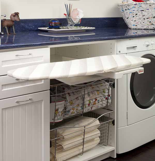Counter in laundry room with built in washer and dryer