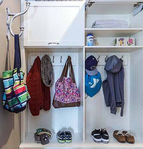 Mudroom storage with hooks holding bags and jackets