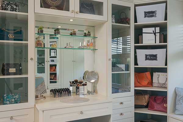 Vanity with sitting area in luxury walk-in closet