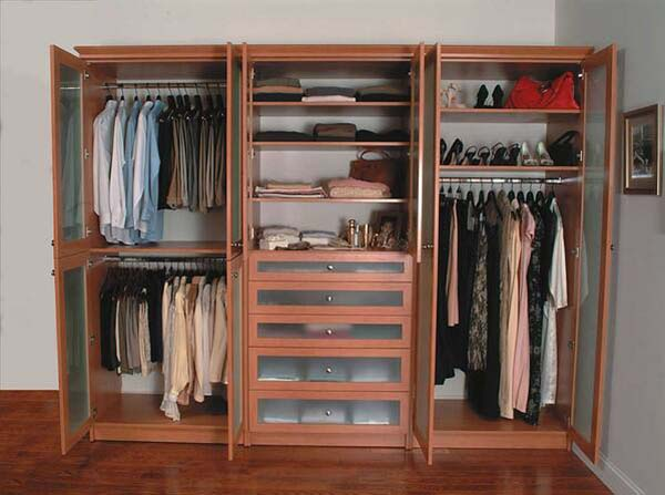 Wardrobe filled with his and her clothes on each side