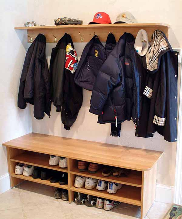 Mudroom with seating area and underneath storage for shoes