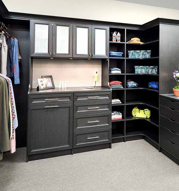 Beautiful wood closet cabinets with puck lighting