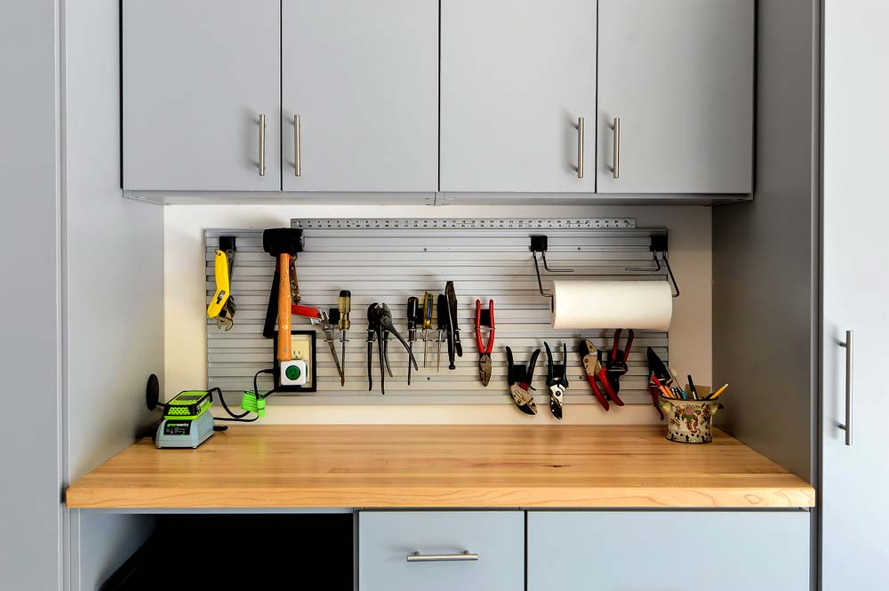 Garage workspace with butcher block and tools hanging neatly above and organized
