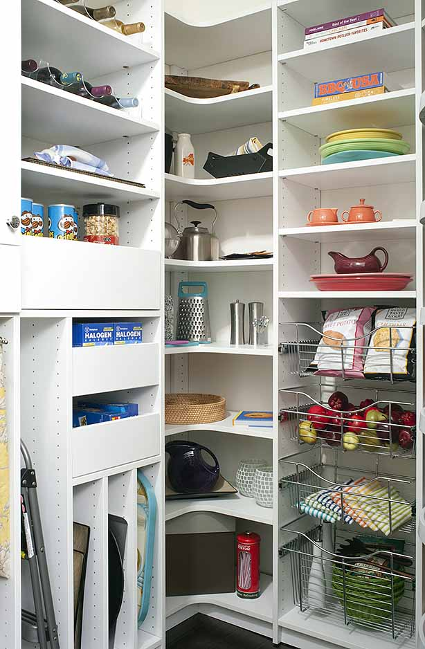 Kitchen utilities neatly organized on pantry shelves