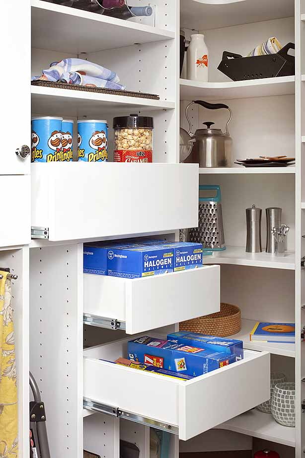 Snacks and bags neatly organized in slide out pantry drawers