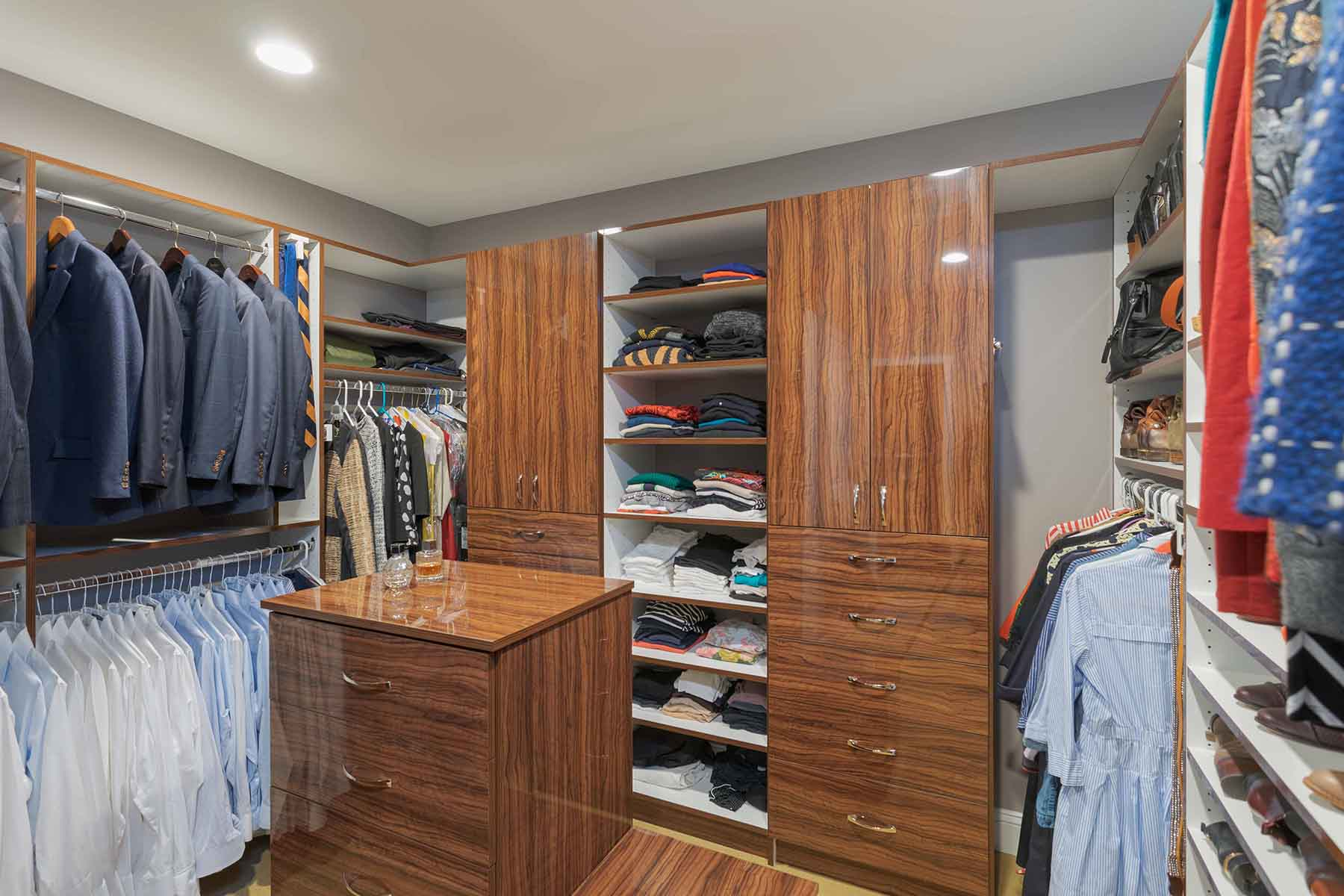 Walk-in closet with suits cared for and neatly hung