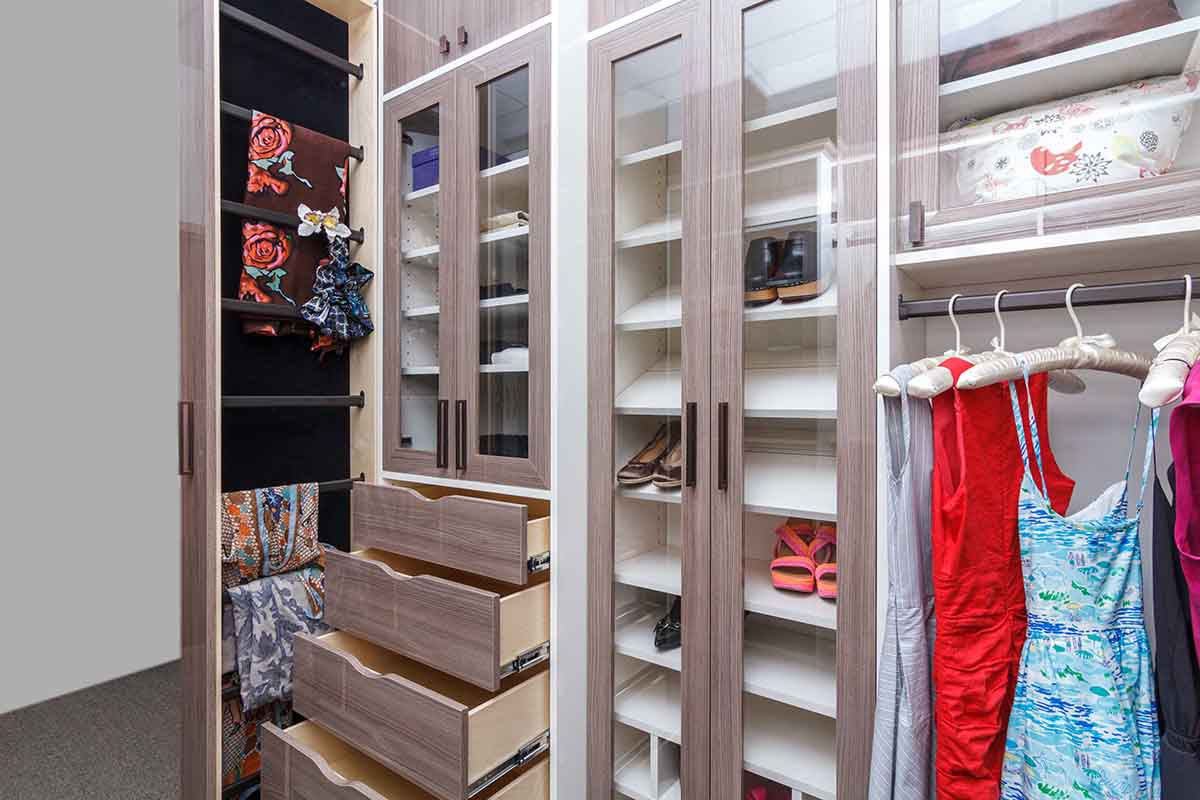 High gloss walk-in closet with deliate wardrobe items hung