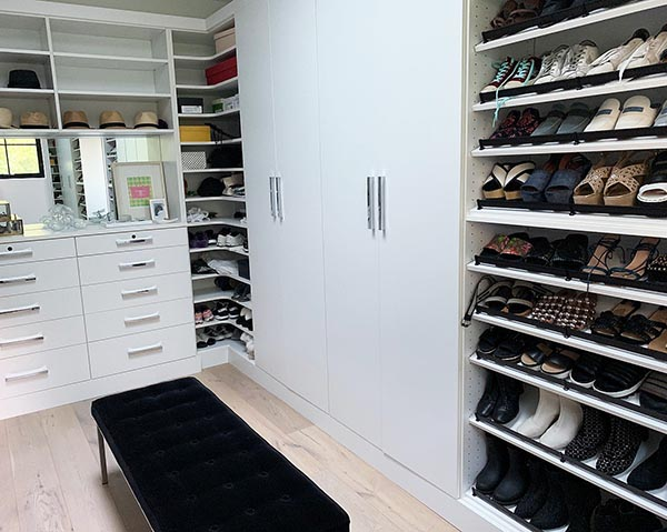 Walk in closet organization system with shoe shelves
