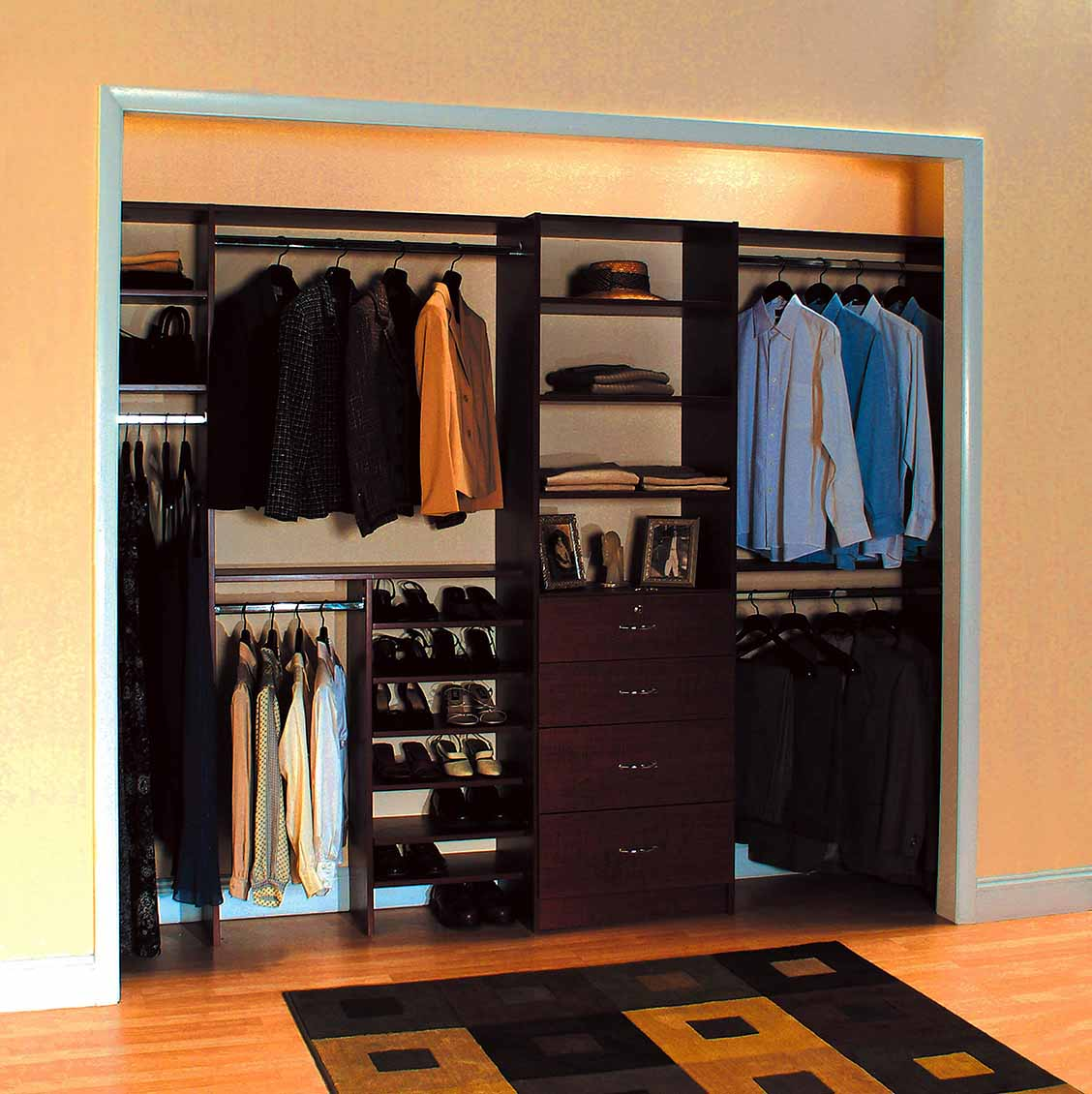 Mens Reach-in closet with wardrobe items neatly organized