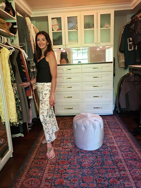 Woman enjoying her new walk-in closet and sitting room