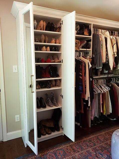 Closet cabinet with shoes organized on shelves