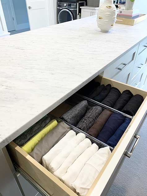Clothing organized in deep drawer with inserts