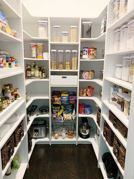 Pantry organized with various food items on shelving