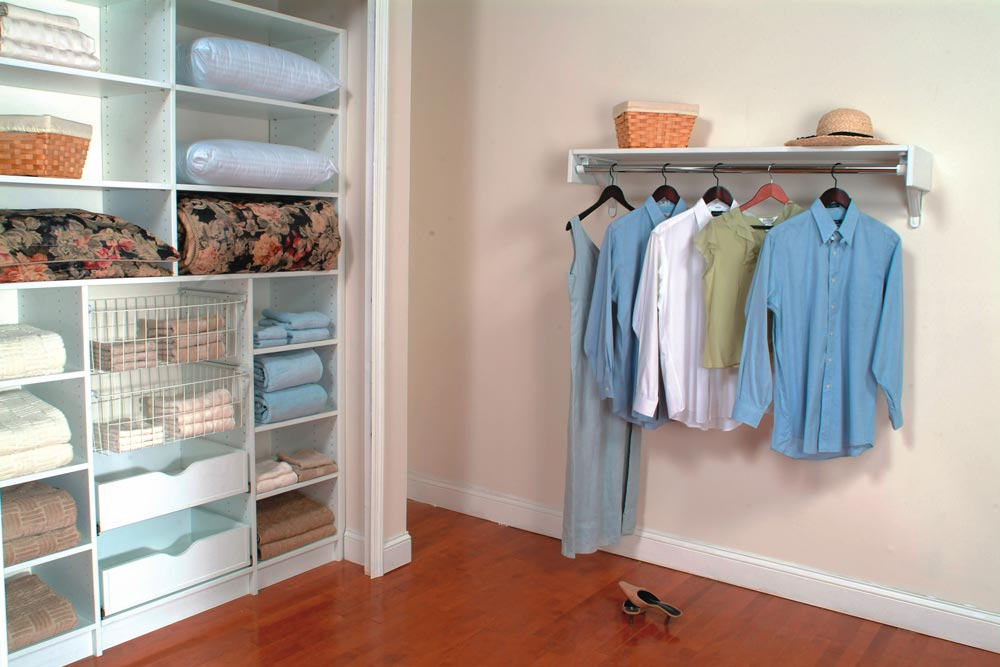 Reach in linen closet with pull out drawers and roll outs to maximize storage