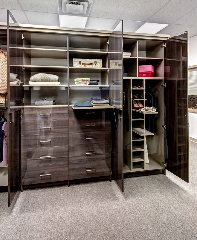 Wardrobe using custom sliding shelves to organize clothing