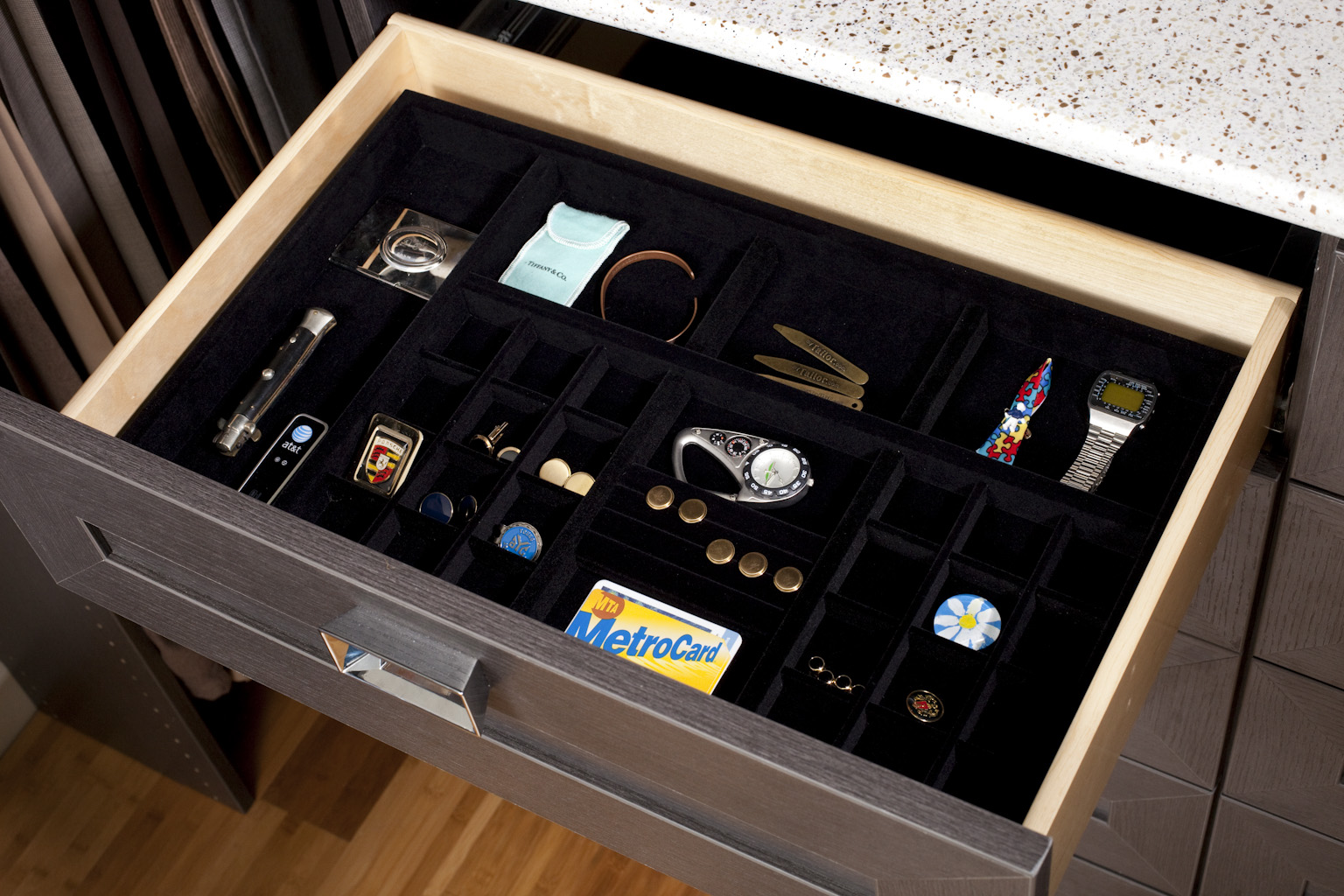Closet drawer decluttered and neatly organized with jewelry door inserts
