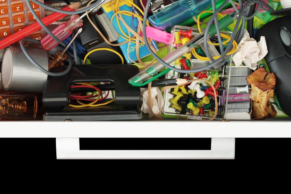 Disorganized kitchen junk drawer